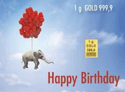 Die besondere Geburtstagsüberraschung in der Motivbox. 1g Goldbarren der ESG mit einem fliegenden Elefanten an Luftballons