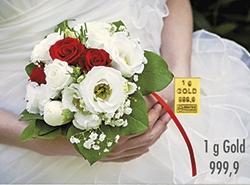 Goldbarren aus 1 Gramm Feingold zur Hochzeit mit einer Braut, die einen Brautstrauß hält als Motiv